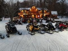 snowmobiles at the main lodge
